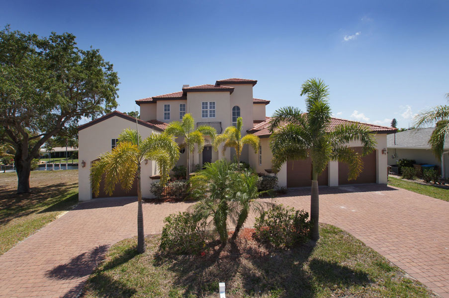 Slideshow of vacation rental property Stunning 5/5/3 Pool Home - Direct Access in Cape Coral