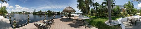 Beautiful waterfront pool home with extensive Tiki hut dock